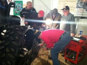 Jim greasing tractor